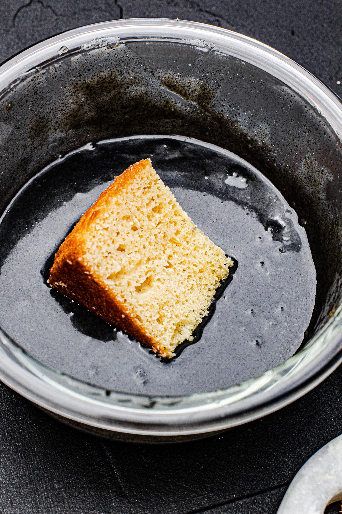 Cake dipped in Black Sesame Sauce
