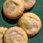 Filipino Neapolitan Sugar Cookies Filled with Yema on a green backdrop.