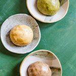 Pandan cookie dough, langka cookie dough and Ube cookie dough in separate bowls.